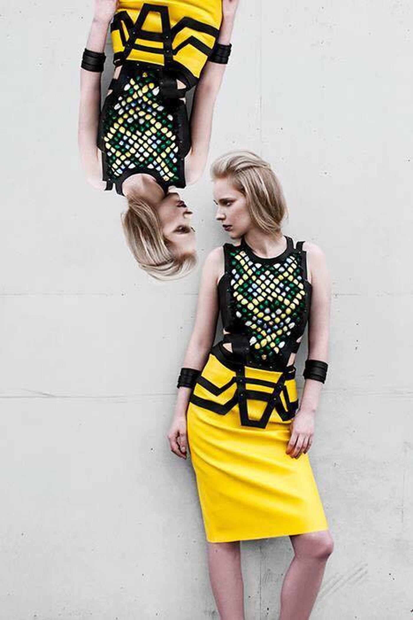 Hand-embroidered leather top with a yellow, leather pencil skirt and geometrical, leather belt