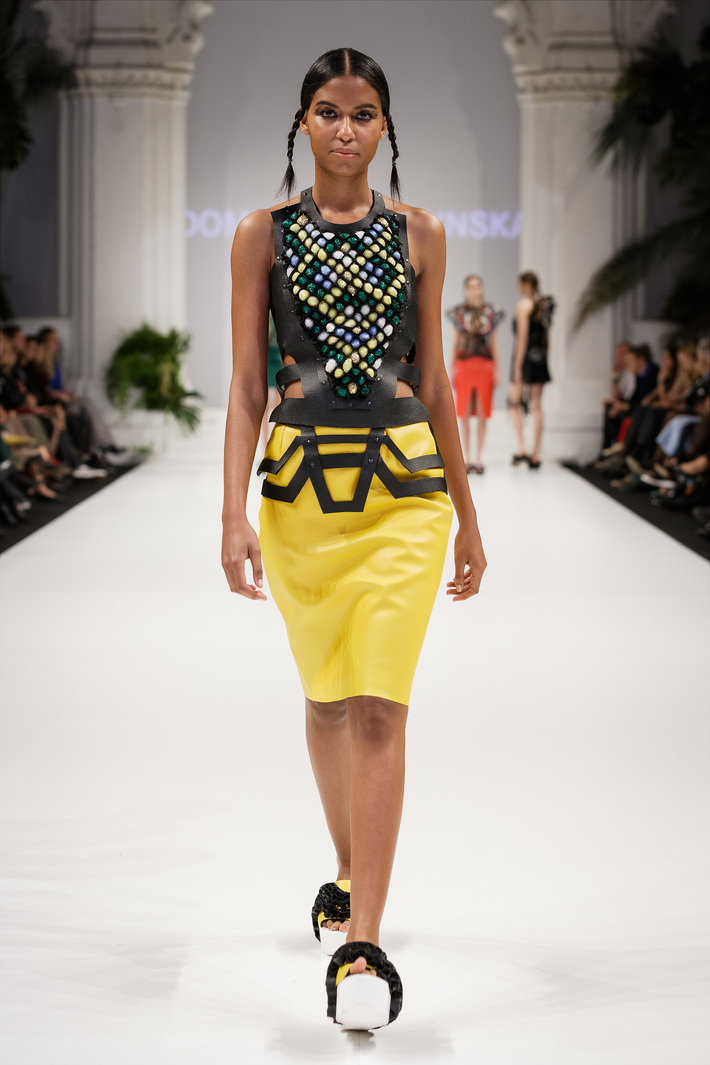 Look 1  Hand-embroidered leather top with a yellow, leather pencil skirt and geometrical, leather belt