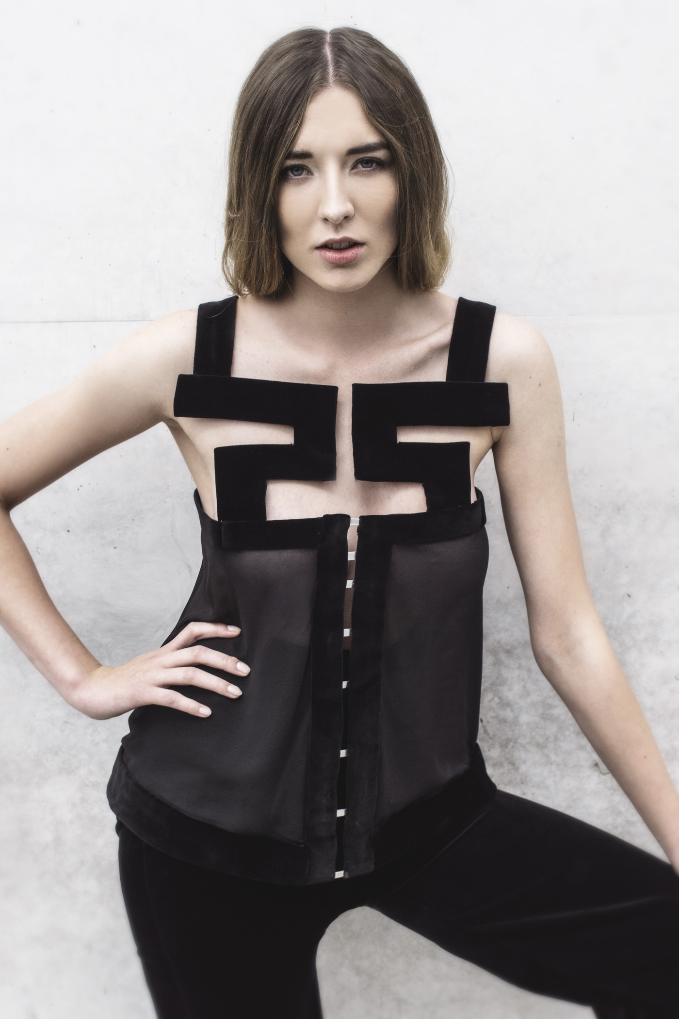 Look 2  Geometrical silk top with high-waisted, velvet trousers