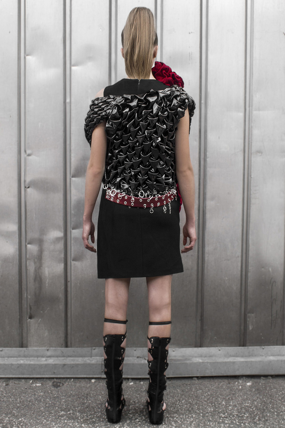 Look 1  Asymmetric cashmere dress with a hand-smocked, lacquered leather vest. Hand embroidered with raw metal embellishments