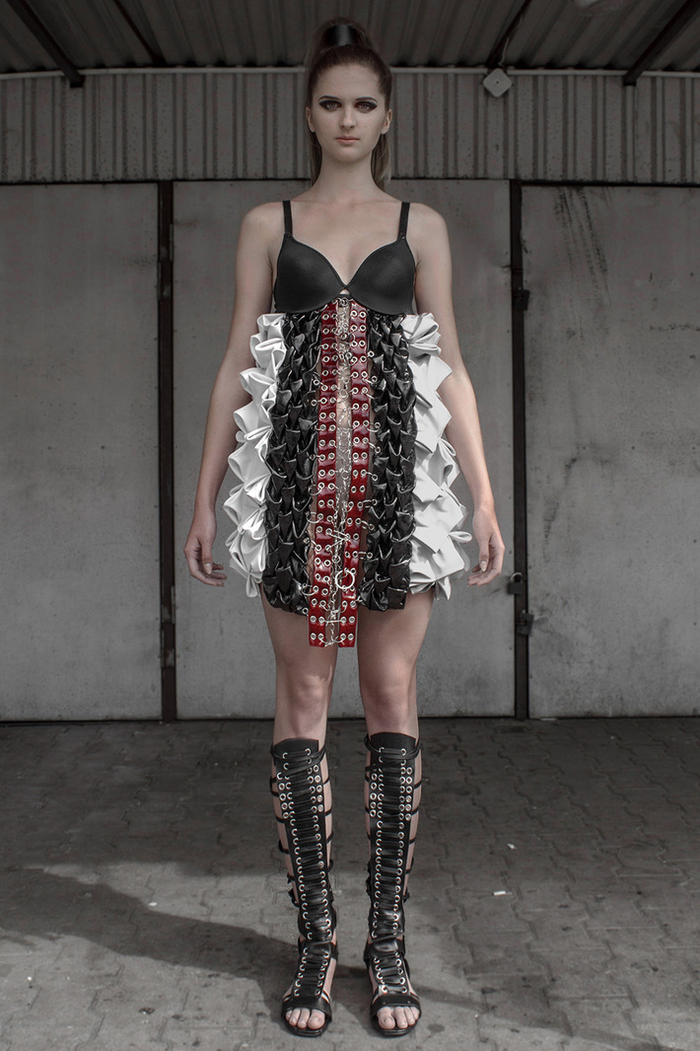 Look 8  Hand-smocked, sculptural, leather dress with raw, metal embellishments