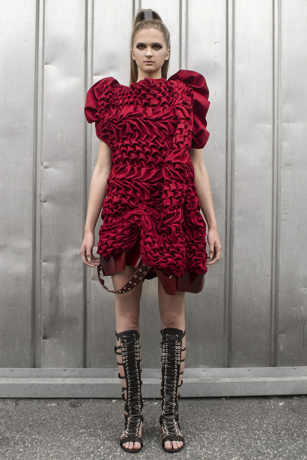Look 5  Hand-smocked, sculptural fine cashmere dress with leather details