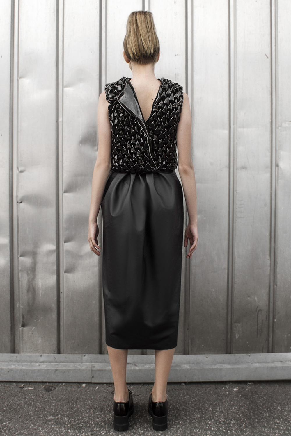 Look 7  Metal embellished and hand-smocked leather top with a long, matt leather skirt