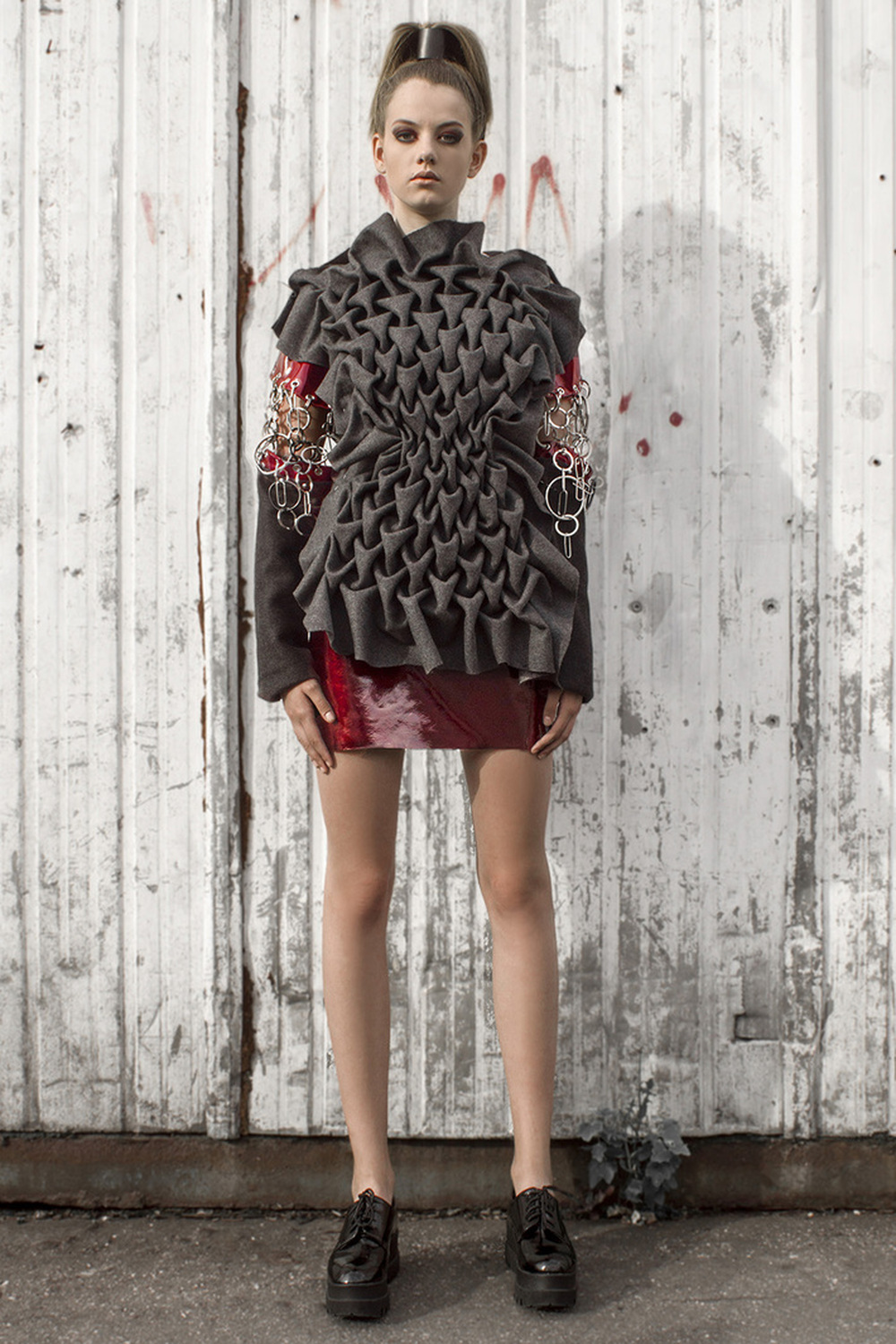 Look 3  Hand-smocked, fine cashmere and wool sweater with leather details and raw metal embellishments
