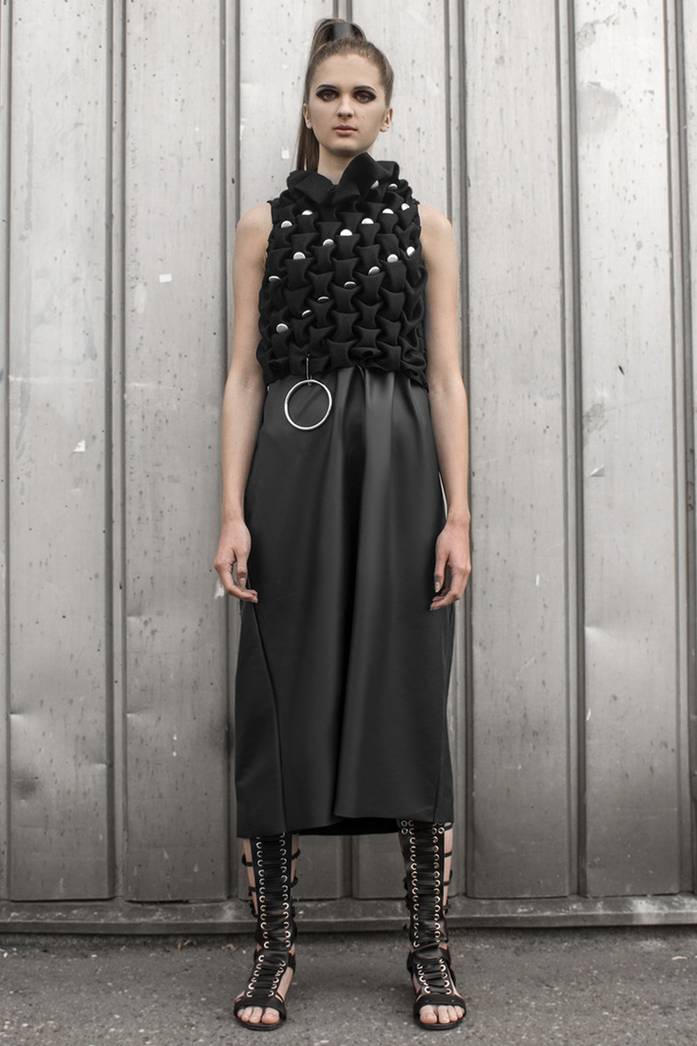 Look 10  Hand-smocked, fine cashmere top with raw metal embellishments and a leather skirt