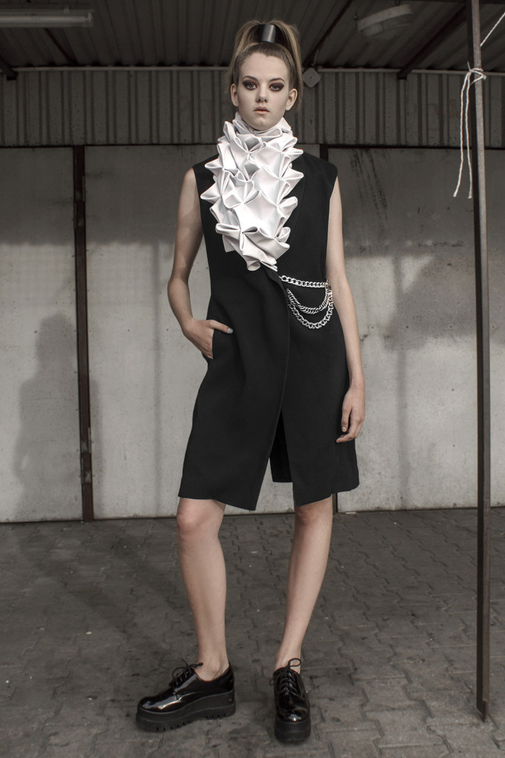 Look 11  Black, wool dress with a hand-smocked, leather  collar