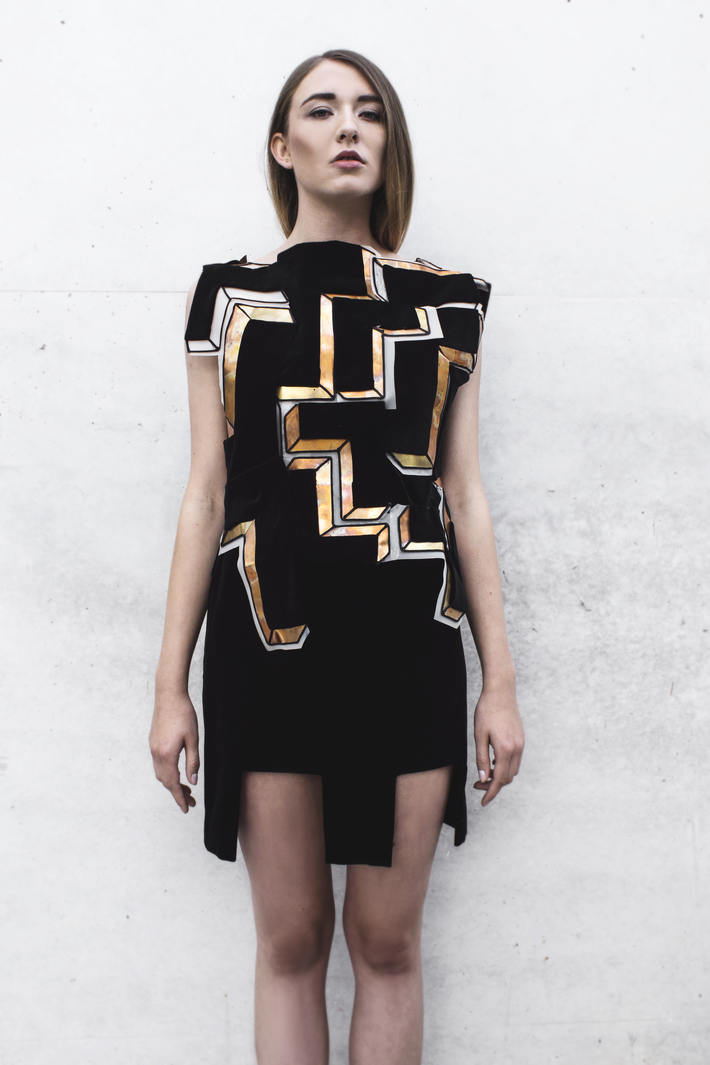 Look 5  Metal embellished, geometrical top with a velvet skirt
